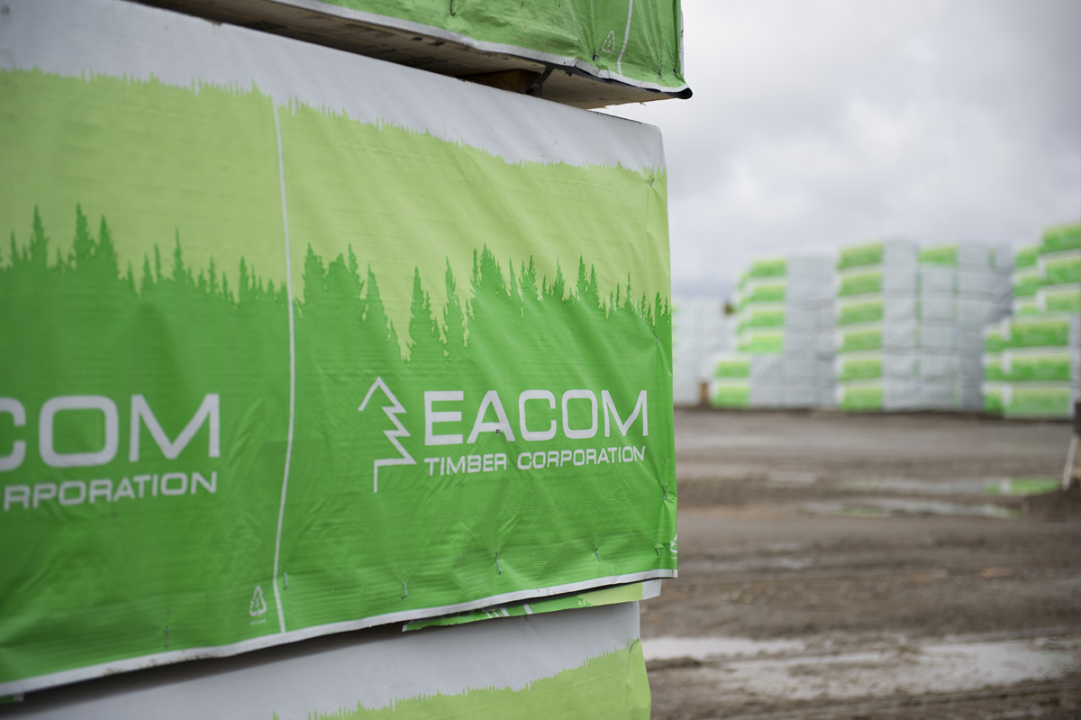 skids of EACOM product wrapped in branded packaging